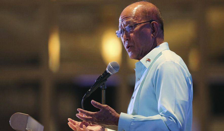 """Philippine Secretary of National Defense Delfin Lorenzana gestures during a conference on """"ASEAN Leadership amid a New World Order"""" at the financial district of Makati, metropolitan Manila, Philippines Wednesday, Nov. 8, 2017. Lorenzana says Philippine President Rodrigo Duterte has stopped construction work on a newly formed sandbar in the disputed South China Sea after a protest from Beijing. (AP Photo/Aaron Favila)"""