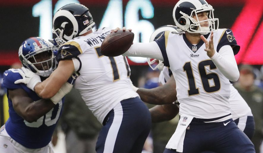 FILE - In this Sunday, Nov. 5, 2017, file photo, Los Angeles Rams' Jared Goff throws a pass during the second half of an NFL football game against the New York Giants in East Rutherford, N.J. Goff's rough rookie season is fading into memory with each outstanding performance this fall for the surging Rams.  (AP Photo/Julio Cortez, File)