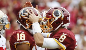 FILE - In this Oct. 15, 2017, file photo, Washington Redskins quarterback Kirk Cousins (8) congratulates wide receiver Josh Doctson (18) after a touchdown during the first half of an NFL football game against the San Francisco 49ers in Landover, Md. Injuries to Jordan Reed and Jamison Crowder put Terrelle Pryor and Josh Doctson front and center for Washington Redskins quarterback Kirk Cousins. Maybe it was just what Cousins needed to develop chemistry with new receivers. (AP Photo/Alex Brandon, File) **FILE**