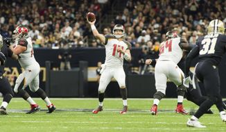 Buccaneers quarterback Ryan Fitzpatrick throws a pass as The New Orleans Saints take on The Tampa Bay Buccaneers in an NFL football game Sunday, Nov. 5, 2017 in Lafayette, La. (Scott Clause/The Daily Advertiser via AP)