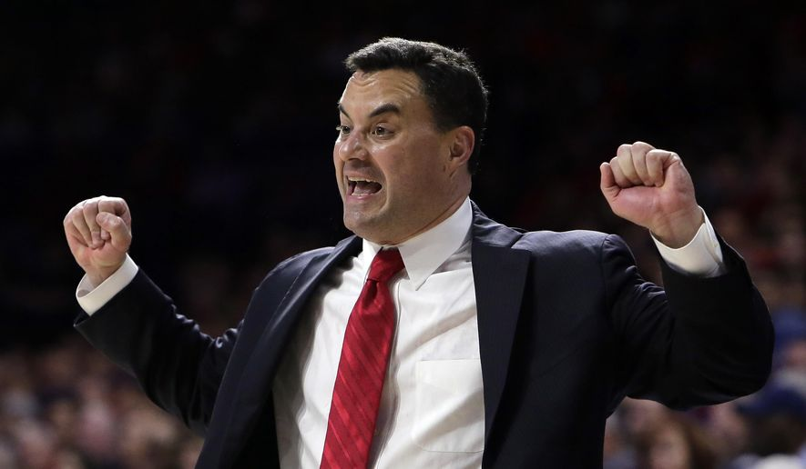 FILE - In this Feb. 11, 2017, file photo, Arizona coach Sean Miller gestures during the first half of the team's NCAA college basketball game against California in Tucson, Ariz.  Miller has the type of team that could end his Final Four-less run. The Wildcats have a strong core of experienced players returning from an Elite Eight team last season to with a stellar recruiting class, highlighted by athletic big man Deandre Ayton. (AP Photo/Rick Scuteri, File) **FILE**