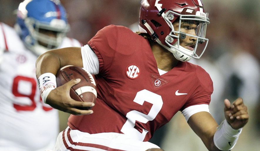 FILE- In this Sept. 30, 2017, file photo, Alabama quarterback Jalen Hurts runs the ball against Mississippi during the first half of an NCAA college football game in Tuscaloosa, Ala. The Southeastern Conference doesn't have any players putting up video game-style numbers. But, there's plenty of big games left for players like Hurts and Georgia's Nick Chubb to produce Heisman moments. (AP Photo/Brynn Anderson, File)