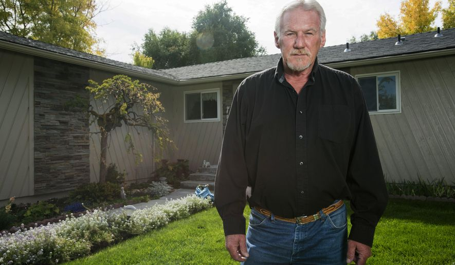 In this Oct. 5, 2017 photo, Bill Hamilton, who received a purple heart during his time in service during the Vietnam War, poses at his residence in Nampa, Idaho. (Chris Bronson /The Idaho Press-Tribune via AP)