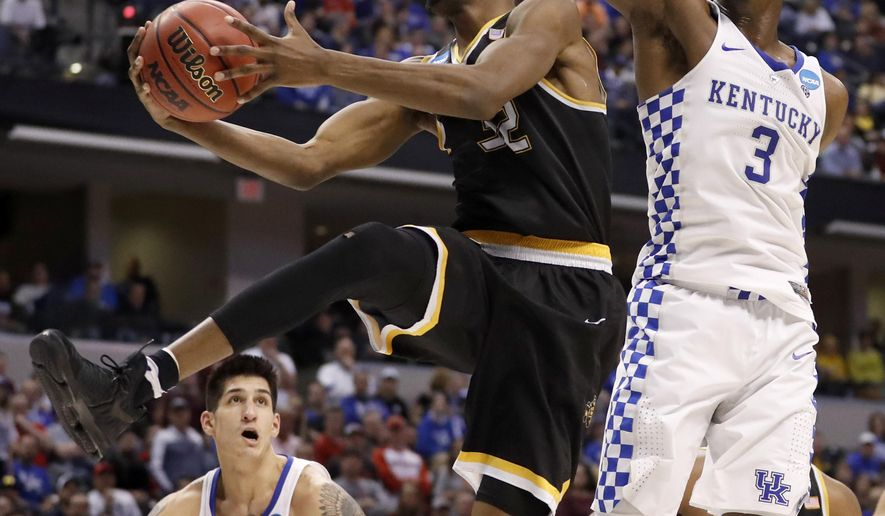 FILE - In this March 19, 2017, file photo, Wichita State's Markis McDuffie (32) heads to the basket past Kentucky's Bam Adebayo (3) and Derek Willis (35) during the second half of a second-round game in the men's NCAA college basketball tournament, in Indianapolis. There are more routes to the Final Four this season than simply Tobacco Road. In fact, the path might go through the Sunflower State. That's where you'll find No. 4 Kansas, seventh-ranked Wichita State and Kansas State. (AP Photo/Jeff Roberson, File)