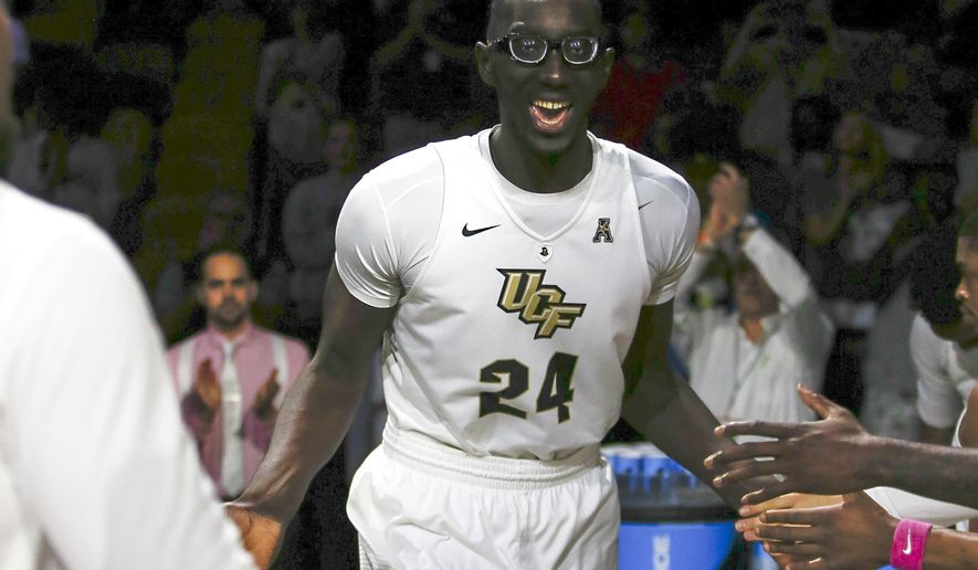 FILE - In this Feb. 26, 2017, file photo, Central Florida center Tacko Fall (24) is introduced before an NCAA college basketball game against Cincinnati, in Orlando, Fla. The tallest player in college basketball strolls the campus at UCF _ not your traditional basketball power. But anybody in the NBA or college hoops who doesn't know 7-foot-6 Tacko Fall should get up to speed on the 21-year-old from Senegal.  (AP Photo/Reinhold Matay, File)