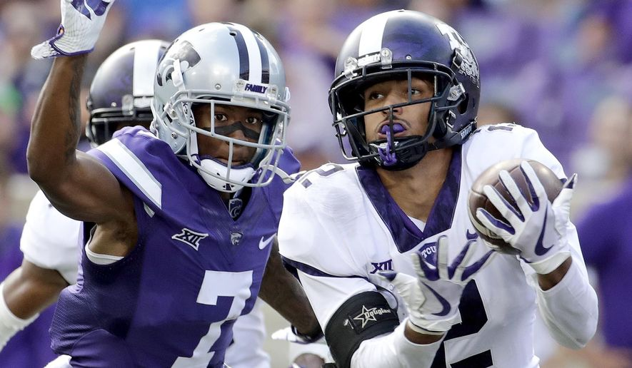 FILE - In this Oct. 14, 2017, file photo, TCU safety Niko Small (2) breaks up a pass intended for Kansas State wide receiver Isaiah Zuber (7) during the second half of an NCAA college football game, in Manhattan, Kan. (AP Photo/Charlie Riedel, File)