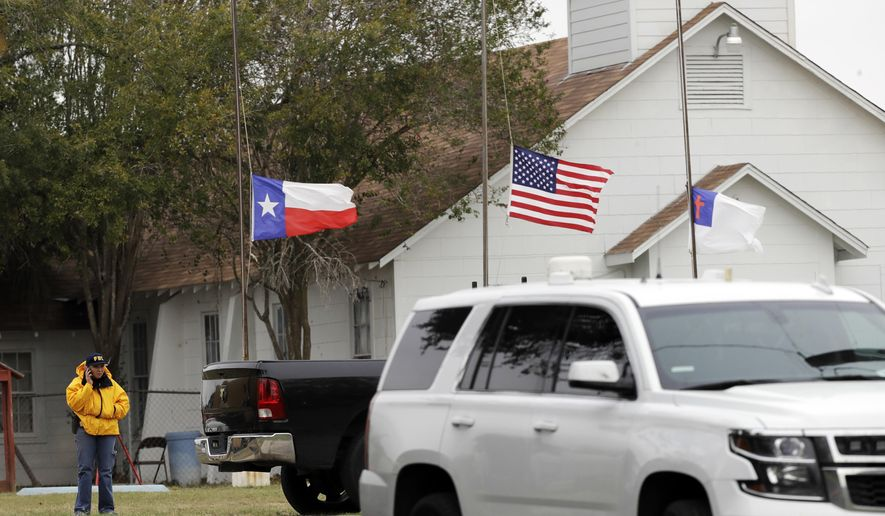 A law enforcement official continues to work the shooting scene at the First Baptist Church Wednesday, Nov. 8, 2017, in Sutherland Springs, Texas. A man opened fire inside the church in the small South Texas community on Sunday, killing more than two dozen and injuring others. (AP Photo/David J. Phillip)