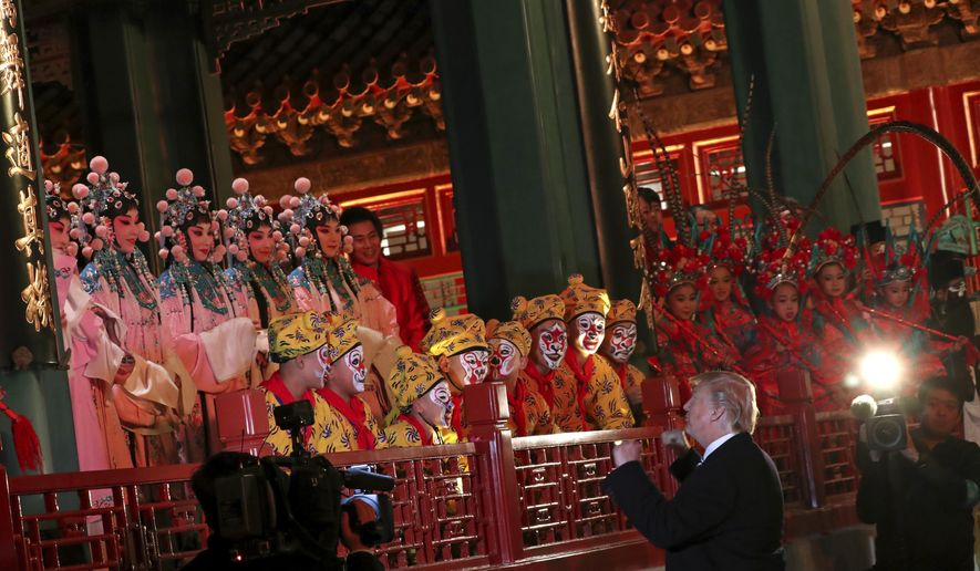 President Donald Trump, center meets opera performers, at the Forbidden City, Wednesday, Nov. 8, 2017, in Beijing, China. Trump is on a five country trip through Asia traveling to Japan, South Korea, China, Vietnam and the Philippines. (AP Photo/Andrew Harnik)