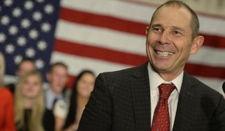 John Curtis, Republican candidate for 3rd Congressional District celebrates his win at Marriott Hotel & Conference Center Tuesday, Nov. 7, 2017, in Provo, Utah. The Republican mayor of the Mormon stronghold of Provo, has won a special election to replace former U.S. Rep. Jason Chaffetz. (Francisco Kjolseth/The Salt Lake Tribune via AP)