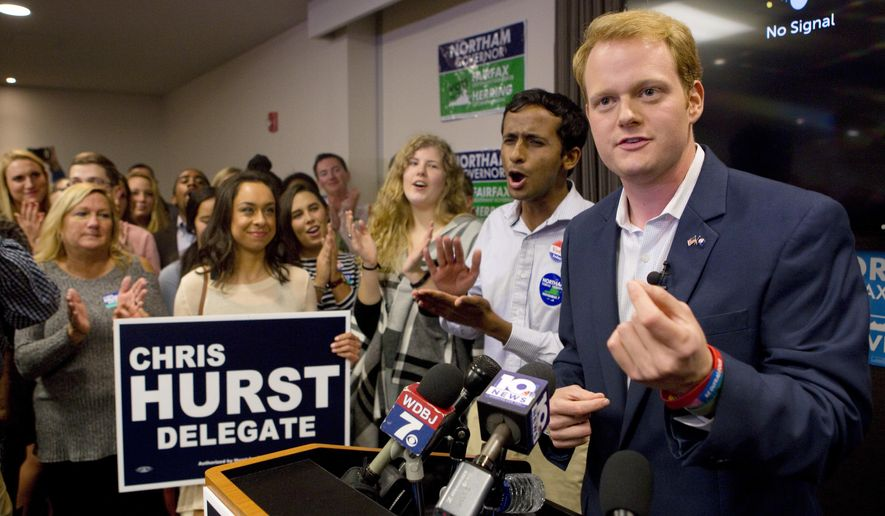 Democrat Chris Hurst, right, defeated Republican incumbent Joseph Yost to win House District 12 on Tuesday, Nov. 7, 2017, in Blacksburg, Va. Hurst celebrates with a packed room of supporters at The Hyatt Place in Blacksburg. (Heather Rousseau/The Roanoke Times via AP)