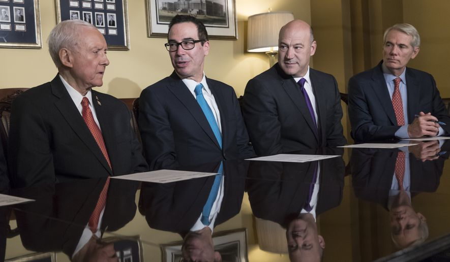 From left: Senate Finance Committee Chairman Orrin G. Hatch, Utah Republican; Treasury Secretary Steven T. Mnuchin; President Trump's top economic adviser Gary Cohn; and Sen. Rob Portman, Ohio Republican, discussed the Senate's version of the Republican tax reform bill on Thursday. (Associated Press)
