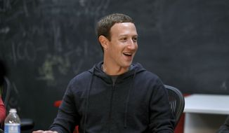 Facebook CEO Mark Zuckerberg meets with a group of entrepreneurs and innovators during a round-table discussion at Cortex Innovation Community technology hub Thursday, Nov. 9, 2017, in St. Louis. (AP Photo/Jeff Roberson) ** FILE **