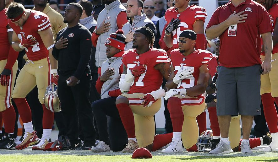 San Francisco 49ers outside linebacker Eli Harold, bottom center, and safety Eric Reid, bottom right, kneel during the national anthem before an NFL football game against the Arizona Cardinals in Santa Clara, Calif. Who anticipated the NFL getting caught up in a back-and-forth with President Donald Trump over players kneeling during the national anthem?  This NFL season has been full of surprises. (AP Photo/Jeff Chiu, File) **FILE**