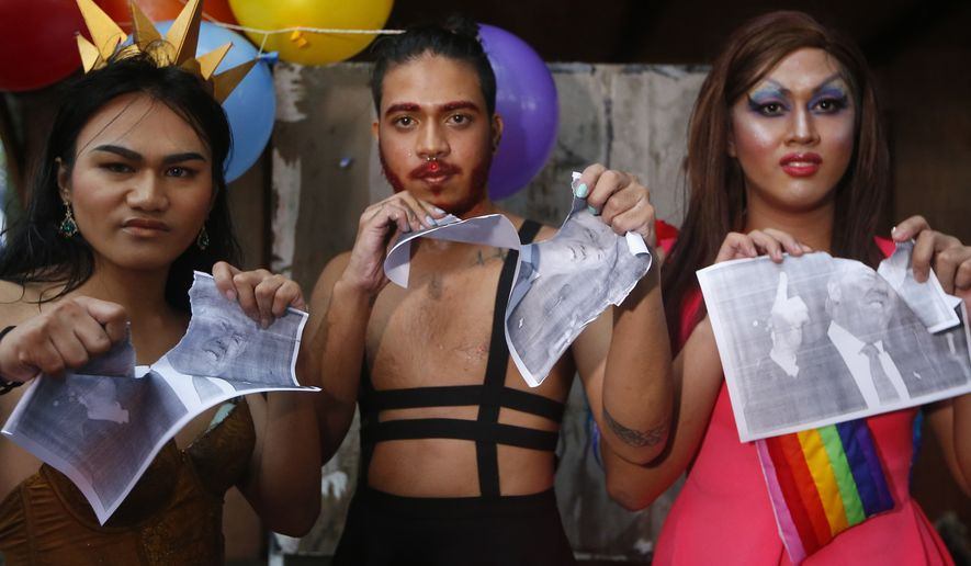 Members of the LGBT community protest the upcoming visit of U.S. President Donald Trump Thursday, Nov. 9, 2017, at the University of the Philippines campus in Los Banos, Laguna province, south of Manila, Philippines. (AP Photo/Bullit Marquez) ** FILE **