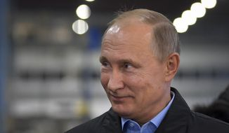 Russian President Vladimir Putin visits Chelyabinsk's Compressor Plant in Chelyabinsk, Russia, Thursday, Nov. 9, 2017. Putin is suggesting that a recent flurry of Russian sports doping allegations could be an American attempt to interfere in next year's Russian presidential election. (Alexei Druzhinin, Sputnik, Kremlin Pool Photo via AP)