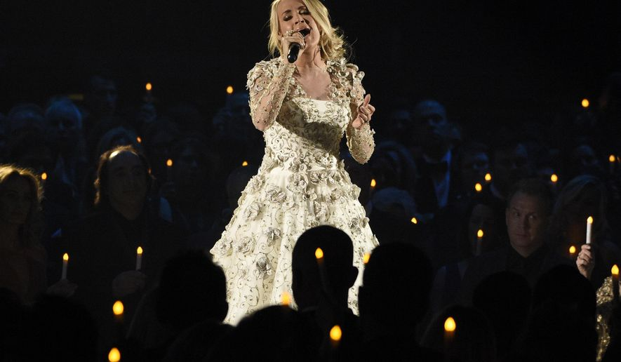 """Carrie Underwood performs """"Softly and Tenderly"""" during an In Memoriam tribute at the 51st annual CMA Awards at the Bridgestone Arena on Wednesday, Nov. 8, 2017, in Nashville, Tenn. (Photo by Chris Pizzello/Invision/AP)"""
