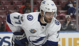 FILE - In this Sept. 28, 2017, file photo, Tampa Bay Lightning defenseman Victor Hedman (77) prepares for a face-off against the Florida Panthers during the first period of an NHL preseason hockey game, in Sunrise, Fla. New NHL faceoff violation enforcement has pressed more defensemen into taking draws this season. Like position players pitching, defensemen taking faceoffs after not practicing is a rare challenge.  (AP Photo/Joel Auerbach, File)