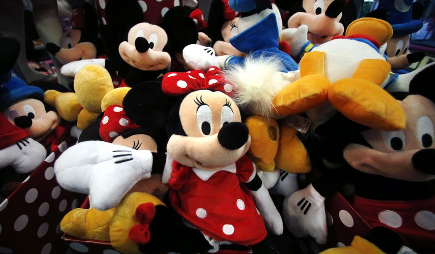 FILE - This Jan. 31, 2014, file photo shows plush Disney characters piled up in a display at a Disney Store in Saugus, Mass. The Walt Disney Co. reports financial results on Thursday, Nov. 9, 2017. (AP Photo/Elise Amendola, File)