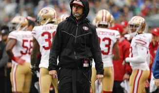 FILE - In this Oct. 29, 2017, file photo, San Francisco 49ers coach Kyle Shanahan stands along the sideline during the teams NFL football game against the Philadelphia Eagles in Philadelphia. The 49ers, who play the New York Giants this week, are still seeking their first win under Shanahan and lost three more players to season-ending injuries this week to raise their total to a league-high 18 players on injured reserve. (AP Photo/Chris Szagola, File)