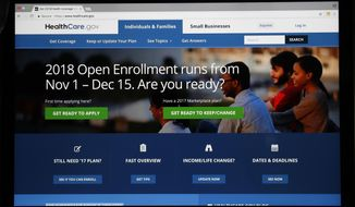The Healthcare.gov website is seen on a computer screen Wednesday, Oct. 18, 2017, in Washington. The government says more than 600,000 people signed up for Affordable Care Act coverage in the first week of open enrollment season, and nearly 8 in 10 of those were current customers renewing their coverage.  (AP Photo/Alex Brandon)
