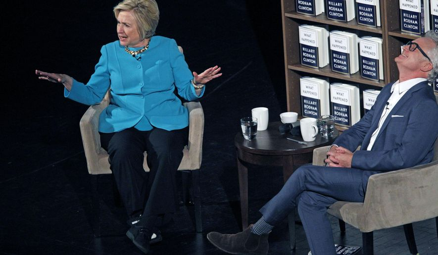 "Hillary Clinton talks with actor Bradley Whitford about her book ""What Happened"", a year and a day after her loss to Donald Trump at the Riverside Theater, Thursday, Nov. 9, 2017 in Milwaukee. (Angela Peterson/Milwaukee Journal-Sentinel via AP)"