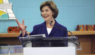 Former first lady Laura Bush, and founder of Texan by Nature, speaks with school children at Palmer Elementary in Pharr, Texas on Wednesday, Nov. 8, 2017. (Delcia Lopez/The Monitor via AP) ** FILE **