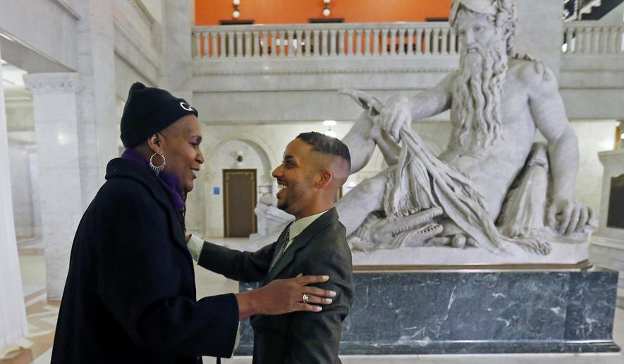Newly elected city council members Phillipe Cunningham, right, and Andrea Jenkins greet each other prior to an interview Thursday, Nov. 9, 2017, at City Hall in Minneapolis. The two black transgender representatives-elect add to what advocacy groups have described as a banner election for transgender people in public office. (AP Photo/Jim Mone)
