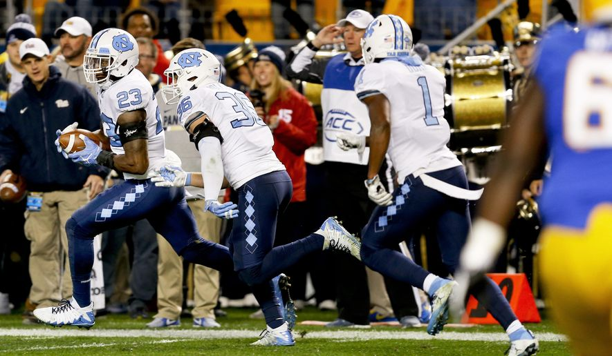 North Carolina linebacker Cayson Collins (23) runs with the ball ahead of teammates after recovering a fumble near the goal line by Pittsburgh wide receiver Quadree Henderson during the second quarter of an NCAA college football game, Thursday, Nov. 9, 2017, in Pittsburgh. (AP Photo/Keith Srakocic)