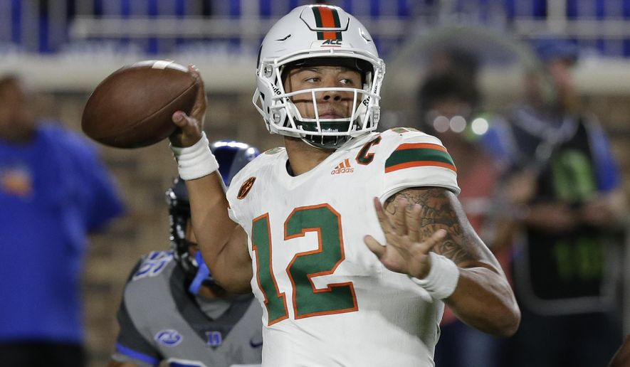 FILE - In this Sept. 29, 2017, file photo, Miami quarterback Malik Rosier (12) looks to pass against Duke during the first half of an NCAA college football game in Durham, N.C. Dual-threat quarterbacks will take center stage when No. 3 Notre Dame visits No. 7 Miami on Saturday night. (AP Photo/Gerry Broome, File)