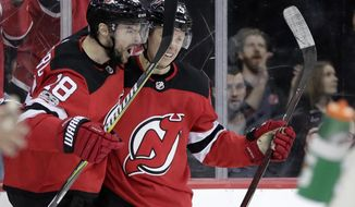 New Jersey Devils right wing Drew Stafford (18) celebrates his goal with Jesper Bratt, of Sweden, during the second period of an NHL hockey game against the Edmonton Oilers, Thursday, Nov. 9, 2017, in Newark, N.J. (AP Photo/Julio Cortez)