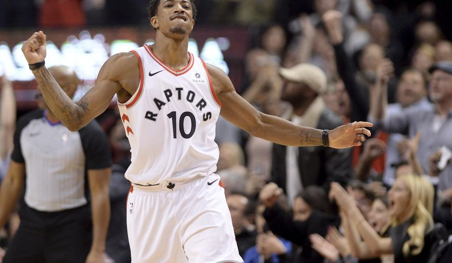 Toronto Raptors guard DeMar DeRozan reacts after sinking a basket in the final seconds against the New Orleans Pelicans during an NBA basketball game Thursday, Nov. 9, 2017, in Toronto. (Nathan Denette/The Canadian Press via AP)