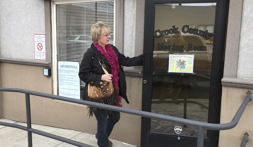 A woman enters the meeting hall of the Crook County commissioners on Wednesday, Nov. 8, 2017 in Prineville, Ore. Commissioners unanimously adopted a land-use plan that says the county will participate fully in planning and decisions on federal lands that comprise about half of the county in central Oregon. (AP Photo/Andrew Selsky)