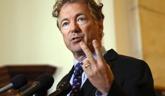 """In this Sept. 25, 2017, file photo, Sen. Rand Paul, R-Ky., speaks during a news conference on Capitol Hill in Washington. Paul says he ended up with six broken ribs after a bizarre attack by his neighbor last week while he was mowing his lawn. Paul writes on Twitter on Nov. 8: """"I appreciate all of the support from everyone. A medical update: final report indicates six broken ribs & new X-ray shows a pleural effusion.""""(AP Photo/Pablo Martinez Monsivais, File)"""