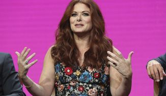 """FILE - In this Aug. 3, 2017 file photo, Debra Messing participates in the """"Will & Grace"""" panel during the NBC Television Critics Association Summer Press Tour at the Beverly Hilton in Beverly Hills, Calif.  Director Alfonso Arau is dismissing Messing's charge that he demeaned her on the set of her first film, """"A Walk in the Clouds."""" Messing spoke up in February about her experience on the movie, a romance released in 1995 co-starring Keanu Reeves.(Photo by Willy Sanjuan/Invision/AP, File)"""