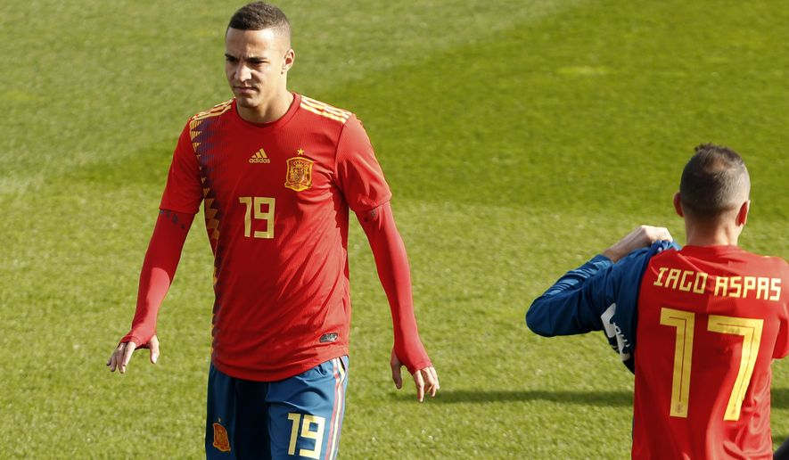 Spain's Rodrigo Moreno, wearing the new soccer kit for the 2018 World Cup, walks along the pitch with teammates during a training session in Las Rozas, outskirts Madrid, Spain, Wednesday, Nov. 8, 2017. Spain jersey's for the World Cup has sparked controversy after being linked to the Republican flag of the 1930s. The jersey has the colors red, yellow and blue but some say that from afar the blue appears to have the same purple tone of the Republican flag used from 1931-39. (AP Photo/Francisco Seco)