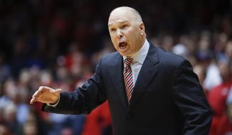 FILE - In This Nov. 19, 2016, file photo, St. Mary's coach Randy Bennett reacts to a referee's call during the second half an NCAA college basketball game against Dayton in Dayton, Ohio. Freshly ousted with an early exit in the West Coast Conference tournament, Saint Mary's made the quiet flight home and returned to campus. Coach Randy Bennett sent home the seniors and called a team meeting for the underclassmen that began about 10 p.m. He did the talking, for about an hour: The Gaels hadn't been close to good enough and this would be a painful lesson. (AP Photo/John Minchillo, File)