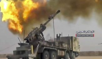This frame grab from video provided Wednesday, Nov 8, 2017, by the government-controlled Syrian Central Military Media, shows firing on militants' positions on the Iraq-Syria border. The Britain-based Syrian Observatory for Human Rights, said that Islamic State militants have withdrawn from their last stronghold following a government offensive and that government forces and allied troops, including Iraqi fighters are combing Boukamal, a strategic town on the border with Iraq, Thursday. (Syrian Central Military Media, via AP)