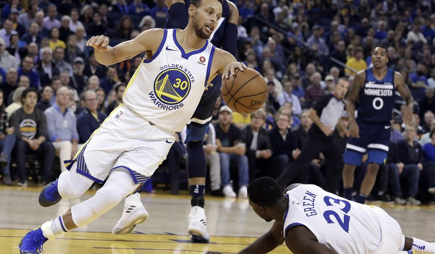 Golden State Warriors' Stephen Curry, left, drives the ball up court around Draymond Green (23) during the first half of an NBA basketball game against the Minnesota Timberwolves on Wednesday, Nov. 8, 2017, in Oakland, Calif. (AP Photo/Ben Margot)