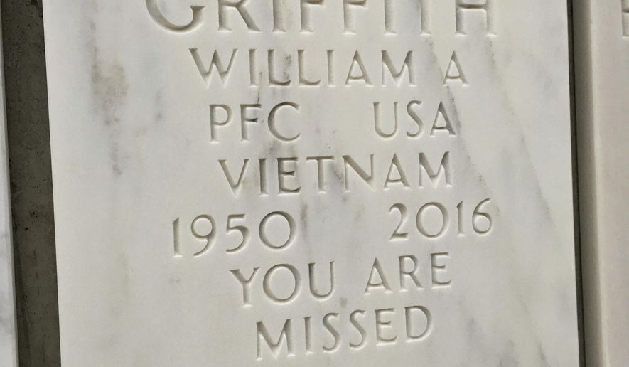 "The cover of the crypt that holds the cremated remains of Vietnam War veteran William Griffith is seen at Great Lakes National Cemetery Thursday, Nov. 9, 2017, in Holly, Mich. Griffith died in December 2016 because of a stunning error at VA hospital in Ann Arbor, Mich. Griffith's father Roy confirmed Thursday, Nov. 9, 2017, that his son, William died when a nurse at the VA hospital mistakenly believed he had a no-resuscitation order. Griffith was suffering from chest pain and stopped breathing while recovering from surgery.A report this week by the Department of Veterans Affairs found the case ""disturbing."" (AP Photo/Ed White)"