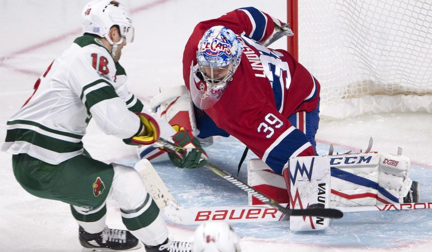 Minnesota Wild left wing Jason Zucker (16) scores on Montreal Canadiens goalie Charlie Lindgren (39) during the third period of an NHL hockey game Thursday, Nov. 9, 2017, in Montreal. (Ryan Remiorz/The Canadian Press via AP)