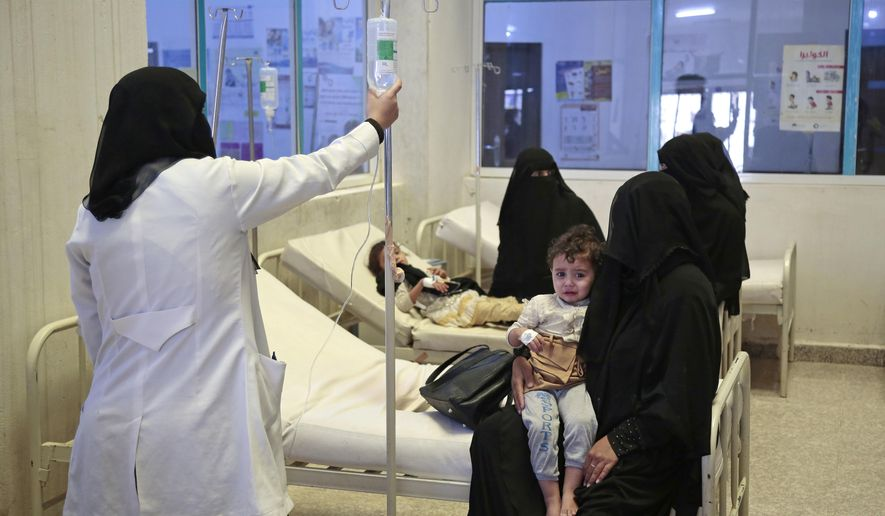 """FILE - In this Jul. 1, 2017 file photo, people are treated for suspected cholera infections at a hospital in Sanaa, Yemen. The United Nations and more than 20 aid groups said Thursday, Nov. 9, 2017, that the Saudi-led coalition's tightening of a blockade on war-torn Yemen could bring millions of people closer to """"starvation and death."""" About two-thirds of Yemen's population relies on imported supplies, said the groups, which include CARE, Save the Children and Islamic Relief. (AP Photo/Hani Mohammed, File)"""