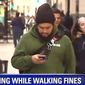 """Chicago aldermen are mulling new measures for """"distracted walking"""" to keep citizens safe. Repeat offenders would be subject to $500 fines. (Image: Fox 32 Chicago screenshot)"""
