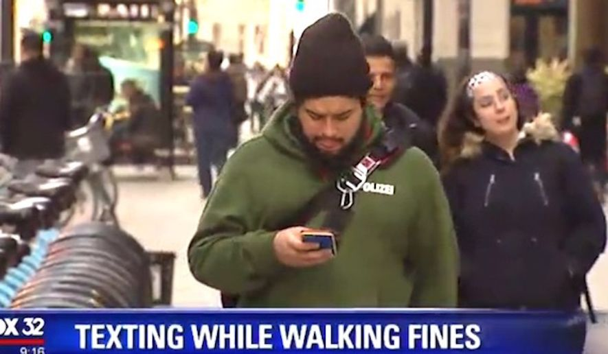 "Chicago aldermen are mulling new measures for ""distracted walking"" to keep citizens safe. Repeat offenders would be subject to $500 fines. (Image: Fox 32 Chicago screenshot)"