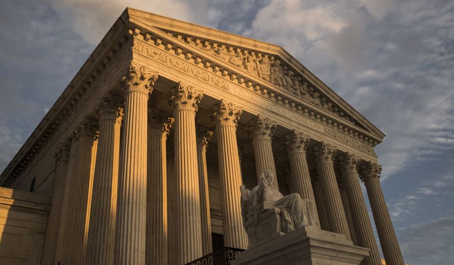 The Supreme Court in Washington is seen here at sunset on Oct. 10, 2017. (Associated Press) **FILE**