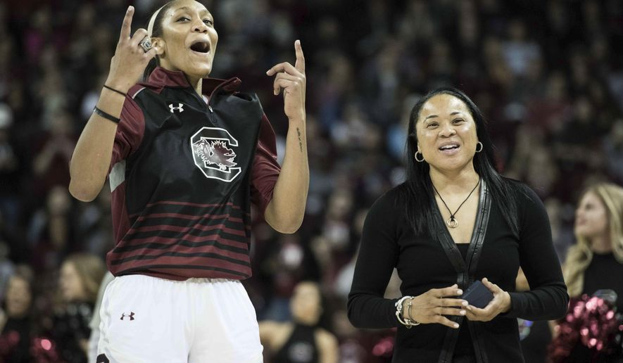 South Carolina forward A'ja Wilson, left, and head coach Dawn Staley celebrate after receiving their national championship rings before an NCAA college basketball game Friday, Nov. 10, 2017, in Columbia, S.C. (AP Photo/Sean Rayford)