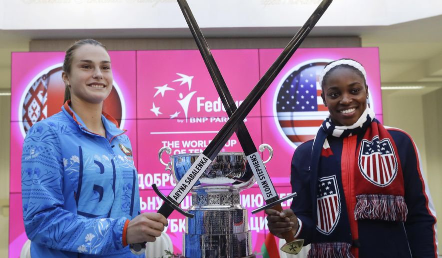 United States Fed Cup team member Sloane Stephens, right, and Belarus' team player Aryna Sabalenka pose for a photo after drawing ceremony, in Minsk, Friday, Nov. 10, 2017. The Fed Cup final matches between Belarus and USA will take place Nov. 11 - 12, 2017. (AP Photo/Sergei Grits)