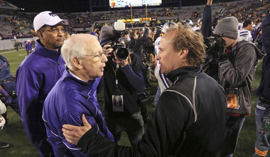 FILE - In this Oct. 20, 2012, file photo, Kansas State coach Bill Snyder, front left, greets West Virginia coach Dana Holgorsen meet following an NCAA college football game in Morgantown, W.Va. Kansas State, which plays bowl-eligible West Virginia on Saturday, needs one more win to be bowl eligible for the eighth straight year and 19th time in coach Snyder's 26 seasons. (AP Photo/Christopher Jackson, File)