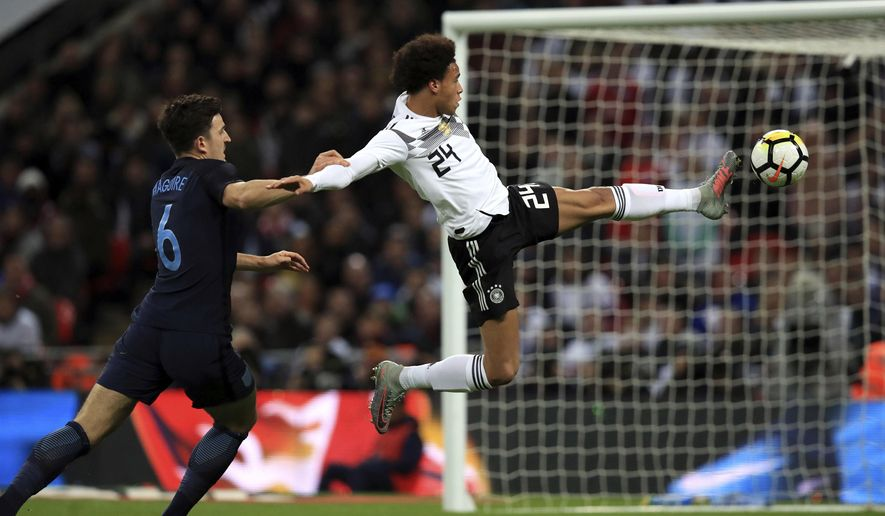 Germany's Leroy Sane, right, controls the ball under pressure from England's Harry Maguire during the international friendly soccer match between England and Germany at Wembley stadium in London, Britain, Friday, Nov. 10, 2017. (Mike Egerton/PA via AP)