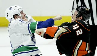 Anaheim Ducks defenseman Josh Manson, right, fights with Vancouver Canucks right wing Derek Dorsett during the third period of an NHL hockey game in Anaheim, Calif., Thursday, Nov. 9, 2017. The Ducks won 4-1. (AP Photo/Chris Carlson)