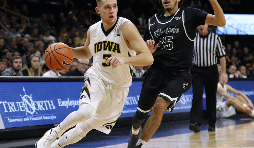 Iowa guard Jordan Bohannon drives past Chicago State guard Rob Shaw, right, during the first half of an NCAA college basketball game, Friday, Nov. 10, 2017, in Iowa City, Iowa. (AP Photo/Charlie Neibergall)
